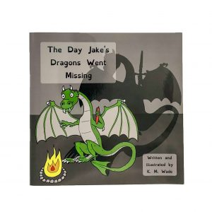 Personalised children's book product shot - The Day Jake's Dragons Went Missing - This is the cover of the book. A green dragon holds its hands up to a fire to warm them. The real dragon is holding a pen in one hand but the dragon's shadow's hand is holding a sword.(the pen is mightier than the sword)