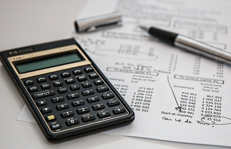 Business budget, calculator and pen
