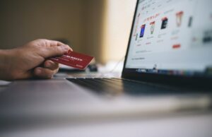 customer onboarding videos increase conversions and loyalty as illustrated by a person holding a credit card