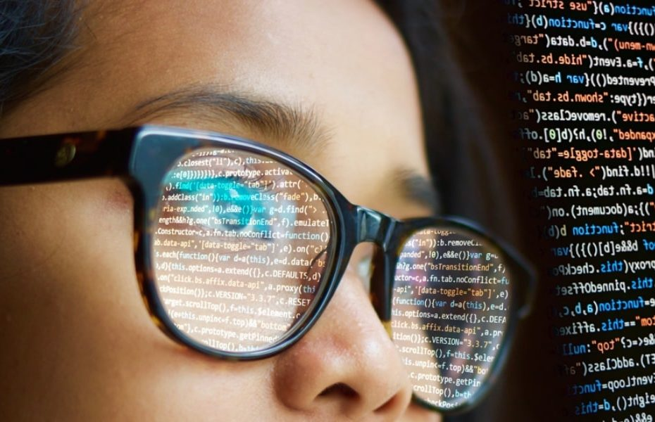 Woman of colour looking at code